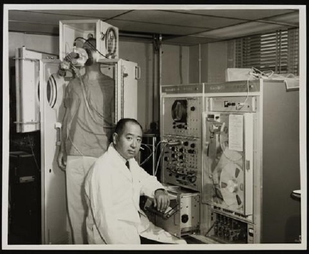 Portrait of Joseph H. Ogura in a laboratory setting.