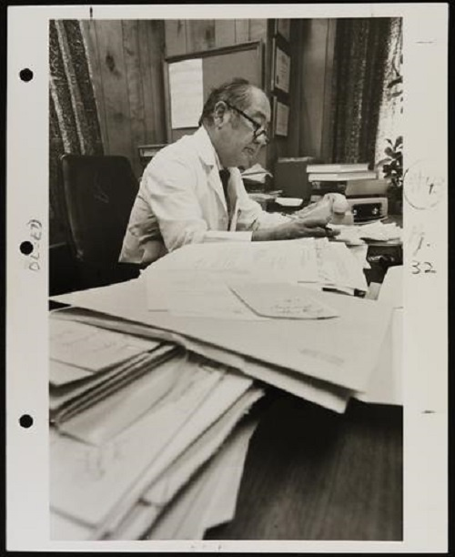 Portrait of Joseph H. Ogura at work in his office.