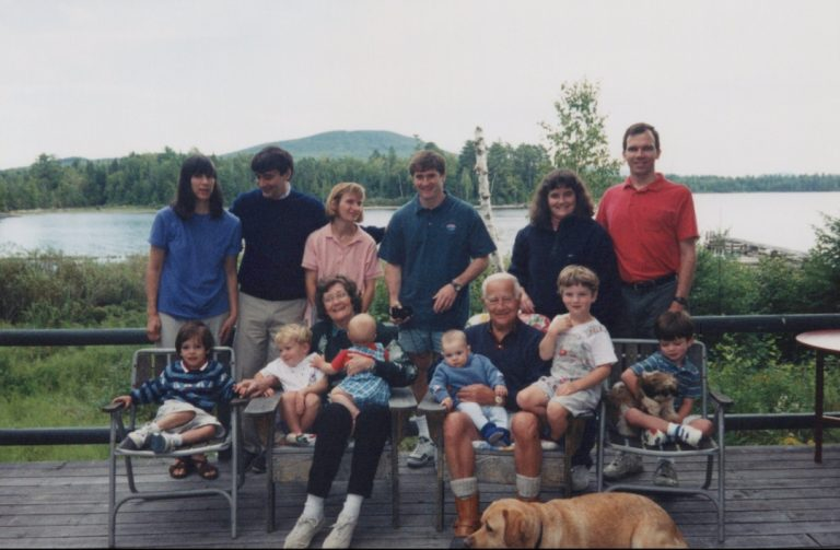 Photo at the Calabresi family cabin in Oquossoc, Maine, August 1998. Steven and his wife Mimi (left), Peter and his wife Katie (middle), Janice and her husband Greg (right) and grandchildren Robert, Augie, Brent, James, Miles and Douglas (left-right) with grandparents Celia and Paul Calabresi.